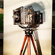 """""""Modern Industry"""" camera.  1 of 1. <br /> 8""""x10"""" film camera made from aircraft aluminum, titanium, brass, copper, stainless steel, forged steel, wood, glass, acrylic, and industry artifacts. <br /> Also, the tripod the camera is sitting on was lent to me by Nathan Lyons for the  """"Modern Industry"""" photo shoots.  The tripod legs belong to Nathan and the tripod head belonged to Edward Weston."""