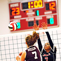 110612  Adron Gardner<br /> <br /> Grants Pirate Deidre Hooks (7), right, deflects a spike from Belen Eagle Victoria Spragg (7) in the 4A volleyball district tournament in Grants Tuesday.
