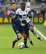 May 16, 2021 - Kansas City, KS, United States:   Sporting Kansas City midfielder Ilie Sanchez (6, left) and Vancouver Whitecaps forward Cristian Dajome (11) vie for the ball.  Sporting KC beat the Vancouver Whitecaps FC 3-0 in a Major League Soccer game. <br /> Photo by Tim Vizer/Polaris