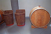 Inside the Oremus winery in Tolcsva, Tokaj - very modern wine making equipment. Examples of old equipment: Two wooden baskets, the famous puttonyos (containing 26 kilos of berries), and one barrel, Gonci (136 litres, g?nci). The number of puttonyos with aszu berries per barrel of base wine gives the number on the bottle. Oremus is owned by the Alvarez family that also owns Vega Sicilia in Spain It is managed by Andras Bacso. Credit Per Karlsson BKWine.com
