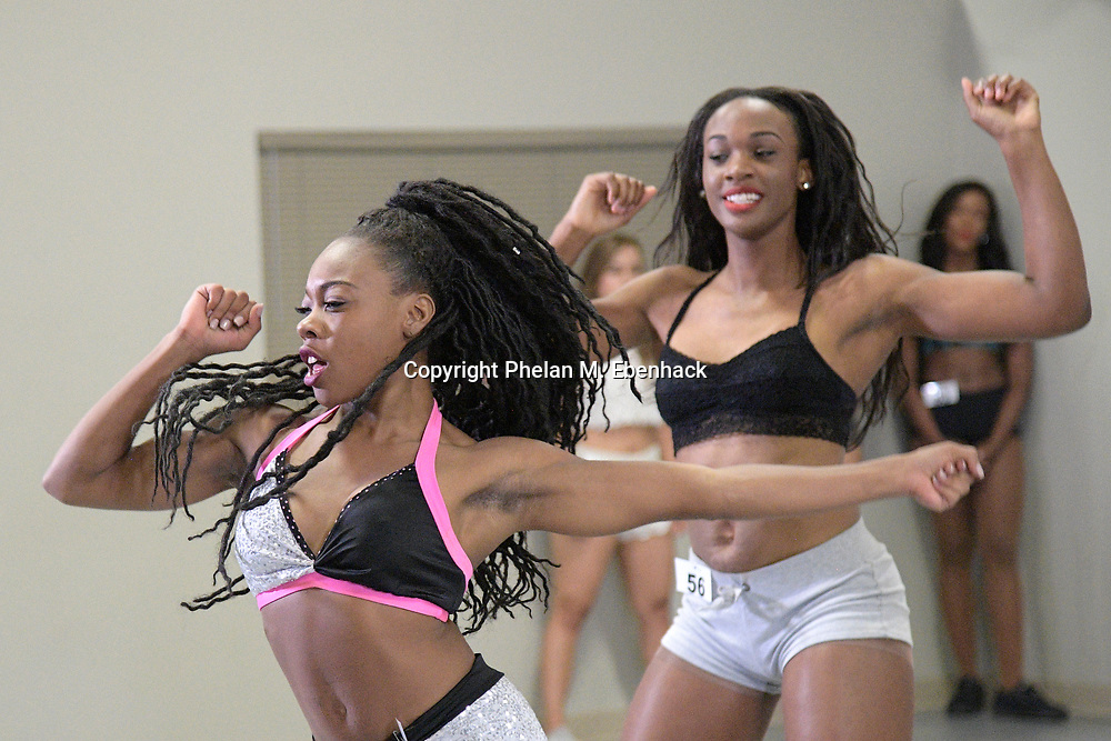 Contestants perform a routine during a tryout for the Miami Dolphins Cheerleaders squad in Orlando, Fla., Saturday, May 6, 2017. (Photo by Phelan M. Ebenhack)