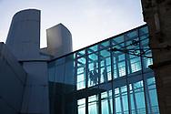 visitors walk through the glass connecting passage of the chocolate museum in the Rheinau harbour, Cologne, Germany.<br /> <br /> Besucher gehen durch den glaesernen Verbindungsgang des Schokoladenmuseums im Rheinauhafen, Koeln, Deutschland.
