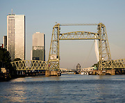 Early morning sunshine on the River Maas and de Hef railway bridge, Koningshaven,  Rotterdam, Netherlands