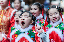 © Licensed to London News Pictures. 14/02/2016. London, UK.   A young girl dancer yawns during the Chinese New Year parade around Chinatown celebrating the Year of the Monkey. Photo credit : Stephen Chung/LNP