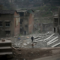 Old housing stock is destroyed by hand in the Hualongqiao District of Chongqing, photographed on Monday 19 March 2007.