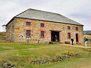 Commissariat Store was built 1825 as part of a convict village, whose history is preserved at Maria Island National Park, Tasmania, Australia. From 1825 to 1832, Darlington was Tasmania's second penal colony (the first was Sarah Island near Strahan).