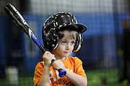 Chester, New York  - A young boys listens to an instructor before taking a swing in the batting cage at the first anniversary open house celebration at The Rock Sports Park on Nov. 12, 2011.