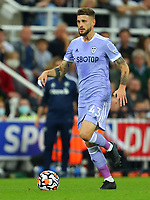 NEWCASTLE UPON TYNE, ENGLAND - SEPTEMBER 17: Mateusz Klich of Leeds United brings the ball forward during the Premier League match between Newcastle United and Leeds United at St. James Park on September 17, 2021 in Newcastle upon Tyne, England. (Photo by MB Media)