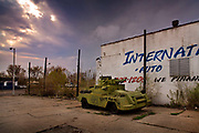"""Abandoned tank in a car park, north Detroit. Known as the world's traditional automotive center, """"Detroit"""" is a metonym for the American automobile industry and an important source of popular music legacies celebrated by the city's two familiar nicknames, the Motor City and Motown. Many neighborhoods remain distressed since the collapse of the motor industry. The state governor declared a financial emergency in March 2013, appointing an emergency manager. On July 18, 2013, Detroit filed the largest municipal bankruptcy case in U.S. history."""