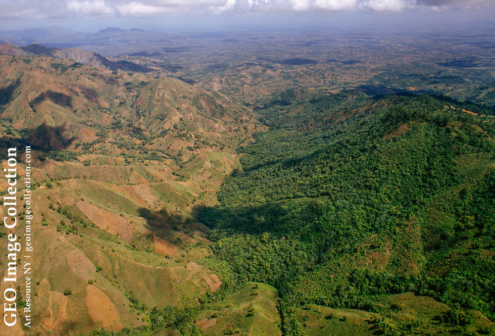 Aerial of deforested Haitian border and green Dominican Republic.