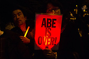 """Hundreds of students and other activists hold candles and signs, some reading """"Abe is Over"""" as they  protest outside the Japanese Prime Minister's office calling on the Japanese Prime Minister, Shinzo Abe and Finance Minister, Taro Aso to resign over a suspected cover-up of the Moritomo Gakuen school  land sale scandal and falsified documents. Kasumigaseki, Tokyo, Japan Friday, March 23rd 2018"""