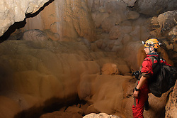 """An expedition member looks at stalactites within the Miao Room Chamber, China's largest cave chamber by volume, in Ziyun County of southwest China's Guizhou Province, April 14, 2016. In 2014, National Geographic announced Miao Room Chamber, with a volume of some 19.78 million cubic meters, as the world's largest cave chamber. A joint caving expedition code-named """"Pearl"""" by explorers and scientists from China and France kicked off here on April 11 during the 19-day exploration, they will conduct comprehensive investigation on famous caves in Guizhou including the Miao Room Chamber and Shuanghe Cave in Suiyang. EXPA Pictures © 2016, PhotoCredit: EXPA/ Photoshot/ Ou Dongqu<br /> <br /> *****ATTENTION - for AUT, SLO, CRO, SRB, BIH, MAZ, SUI only*****"""