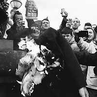 Liverpool, UK, 17th April, 2013. An effigy of Margaret Thatcher is burned on the steps of St Georges Hall in Liverpool.