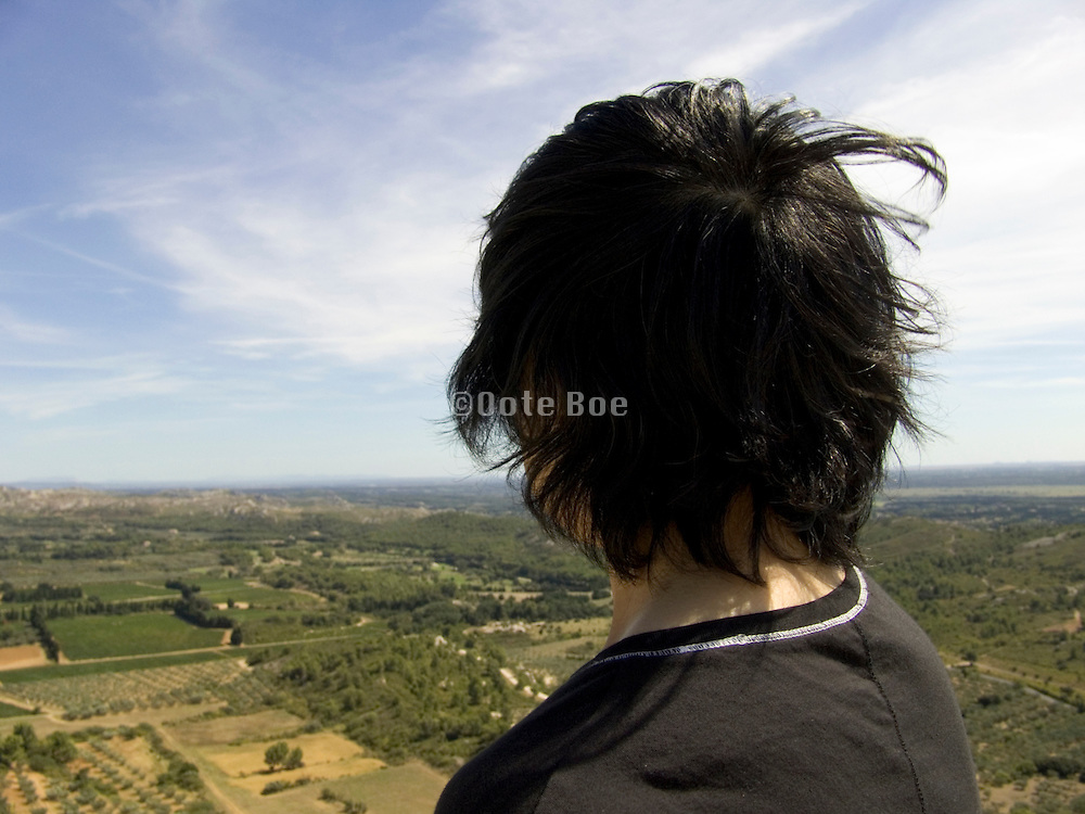 woman looking out over a valley France Provence
