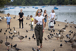 © Licensed to London News Pictures. 09/07/2021. Members of the public relax In warm conditions in Hyde Park, central London on a summer's day. Wet and warm conditions are expected over the weekend. Photo credit: Ben Cawthra/LNP