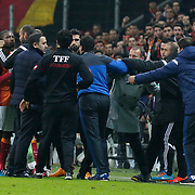 Galatasaray's Aurelien Bayard Chedjou Fongang (L) and Istanbul Basaksehir's coach Abdullah Avci (4ndR) during their Turkish Super League soccer match Galatasaray between Istanbul Basaksehir at the AliSamiYen Spor Kompleksi TT Arena at Seyrantepe in Istanbul Turkey on Saturday, 14 March 2015. Photo by Aykut AKICI/TURKPIX