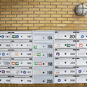 Rumlepotten Community, Aarhus, Denmark, February 6, 2010. <br /> Mail boxes.<br /> The community of Rumlepotten, born in 1985 in the south of Aarhus, consists of 32 apartments with associated gardens.<br /> The residents eat dinner together four times a week, working in shifts in the kitchen.<br /> All adults are invited to participate in a working day one Saturday a month to cooperate for the spaces maintenance.<br /> Shared responsibility and tolerance are key words in the community.