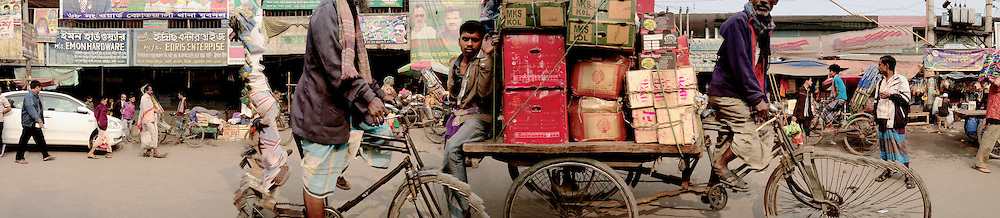 DHAKARAMA by Enamul Hoque<br /> <br /> Dhakarama is a photographic exhibition of street panoramas of Dhaka by London<br /> based photographer Enamul Hoque. <br /> <br /> Hoque regularly visits Dhaka and continues<br /> to experiment and push the boundaries of digital technology in archiving and creating an intimate portrait of an evolving megacity.<br /> <br /> Dhaka is the capital of Bangladesh and is one of the most densely populated megacities in the world, with a population of over 17 million people. <br /> <br /> The images are of some of the main streets of Dhaka, and reflect the colour, vitality, chaos and<br /> life in a densely packed city.<br /> These photographs were taken 2013 onwards and reflect his continual interest in representation the daily life and form part of his work as a visual artist.<br /> <br /> It contrasts the structured / controlled work that he is regularly involved in and provides an<br /> insight into the way photography can be used to represent motion.