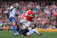 Yohan Cabaye of Crystal Palace fouls Francis Coquelin of Arsenal. Barclays Premier league match, Arsenal v Crystal Palace at the Emirates Stadium in London on Sunday 17th April 2016.<br /> pic by John Patrick Fletcher, Andrew Orchard sports photography.