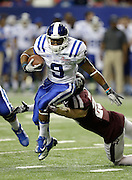 ATLANTA, GA - DECEMBER 31:  Running back Josh Snead #9 of the Duke Blue Devils eludes defensive back Clay Honeycutt #25 of the Texas A&M Aggies during the Chick-fil-A Bowl game at the Georgia Dome on December 31, 2013 in Atlanta, Georgia.  (Photo by Mike Zarrilli/Getty Images)