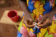 Rita Sahi, 25, who is 7-month pregnant with her third child, takes malaria prophylaxis she received for free from the health center as part of a ECHO-funded programme in Man, Cote d'Ivoire on Wednesday July 24, 2013.