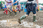 The mud makes for heavy going. The 2013 Glastonbury Festival, Worthy Farm, Glastonbury. 28 June 2013. © Guy Bell, guy@gbphotos.com, all rights reserved