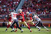 San Francisco 49ers running back Mike Davis (22) stiff arms Houston Texans defensive back Corey Moore (43) at Levi's Stadium in Santa Clara, Calif., on August 14, 2016. (Stan Olszewski/Special to S.F. Examiner)