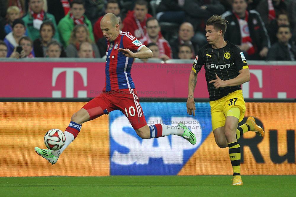 01-11-2014 GER: FC Bayern Munchen vs Borussia Dortmund, Munchen<br /> Arjen Robben #10 (FC Bayern Muenchen) und Erik Durm #37 (Borussia Dortmund) <br /> *****NETHERLANDS ONLY*****