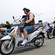 One of the smaller bikes participating in the annual Rolling Thunder motorcycle rally through downtown Washington DC on May 29, 2011. This shot was taken as the riders were leaving the staging area in the Pentagon's north parking lot, where thousands of bikes and riders had gathered.