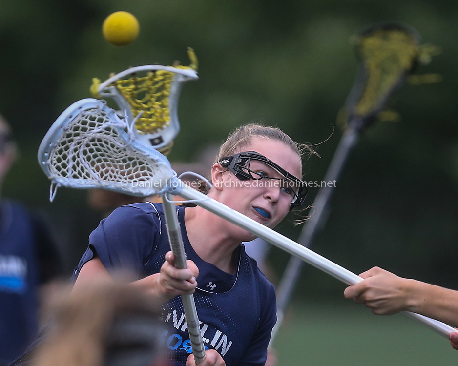 (7/13/20, MEDWAY, MA) Franklin's Katie Jones shoots and scores during the Gold Star Lax League game against Walpole at Medway High School on Monday. [Daily News and Wicked Local Photo/Dan Holmes]
