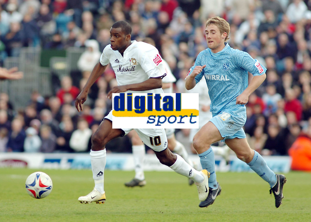 Photo: Kevin Poolman.<br />Milton Keynes Dons v Tranmere Rovers. Coca Cola League 1. 29/04/2006. Mk's Izale McLeod gets away from Danny Harrison.