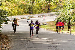elite men leaders Sambu, Salel pass elite women leaders Wacera, Rotich, Limo, Oljira going opposite way near mile 11