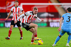Oli McBurnie of Sheffield United looks for a way around Aaron Cresswell of West Ham United - Mandatory by-line: Nick Browning/JMP - 22/11/2020 - FOOTBALL - Bramall Lane - Sheffield, England - Sheffield United v West Ham United - Premier League