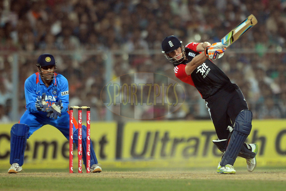 Mahendra Singh Dhoni captain of India  looks on as Craig Kieswetter of England bats during the T20 International match between India and England held at the Eden Gardens Stadium, Kolkata on the 29th October 2011..Photo by Pal Pillai/BCCI/SPORTZPICS