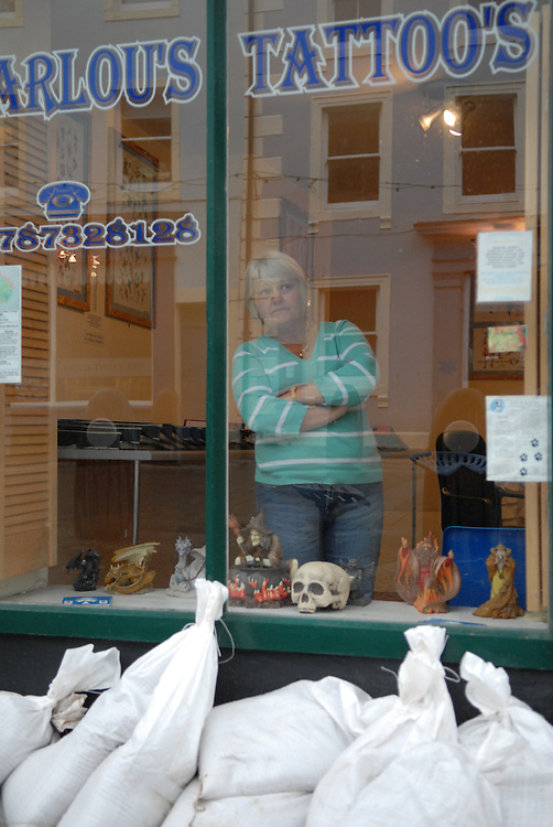 Owner of tattoo parlow in Cockmouth following the floods in Novermber 2009