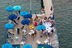 Sorrento, Italy, September 16 2017. People enjoy late afternoon drinks on a jetty in Marina Santo Francesco, Sorrento, Italy. © Paul Davey