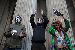 © licensed to London News Pictures. London, UK 13/10/2012. Occupy London protesters celebrating the first anniversary of Occupy London Stock Exchange campaign and St Paul tent city, which was evicted earlier this year, outside St Paul's Cathedral in London. Photo credit: Tolga Akmen/LNP