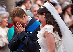 STRICT EMBARGO TO 00:01 FRIDAY 15 APRIL 2011 © licensed to London News Pictures. LONDON, UK  12/04/11.Katherine Middleton and Prince William. The filming of a new T-Mobile advert in which Kate Middleton and Prince William lookalikes pretend to get married at a mock royal wedding. The filming took place at St Bartholomew the Great Church in London. All the main royal family members and the Arch Bishop of Canterbury were played by actors. The actors danced down the aisle with moves choreographed by Louie Spence. Please see special instructions. Photo credit should read Cliff Hide/LNP.