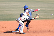 CARY, NC - MARCH 04: UMass Lowell's Steve Passatempo (00) slides into second base, beating the tag by Notre Dame's Cole Daily (6). The University of Massachusetts Lowell River Hawks played the University of Notre Dame Fighting Irish on March 4, 2017, at USA Baseball NTC Stadium Field in Cary, NC in a Division I College Baseball game, and part of the Irish Classic tournament. UMass Lowell won the game 8-0.