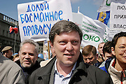 Moscow, Russia, 01/05/2004.&#xD;Annual Mayday celebrations in Moscow. Pro democracy demonstrators led by Grigory Yavlinsky and Irina Khakamada outside the Lubyanka, the KGB headquarters. Speakers accused President Vladimir Putin of creating a police state, and many held posters of jailed businessman Mikhail Khodorkovsky.&#xD;<br />