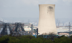© Licensed to London News Pictures. 22/04/2012..Teesside, England..Three huge symbols of Teessides industrial heritage came tumbling down today...Two obsolete cooling towers and a chimney stack on a former production area at Wilton International, near Redcar, where demolished...A controlled demolition took place at the old ICI Nylon Works, where thousands of Teessiders were employed at its height in the 1970s...A team has been working on the dismantling of closed plants on site for more than a year and the site may be redeveloped after demolition..Photo credit : Ian Forsyth/LNP