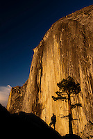 A hiker takes in the view of Half Dome at sunset in Yosemite National Park, California.