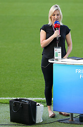 Sky Sports presenter Kelly Cates with her handbag pitchside before the Premier League match at the AMEX Stadium, Brighton.