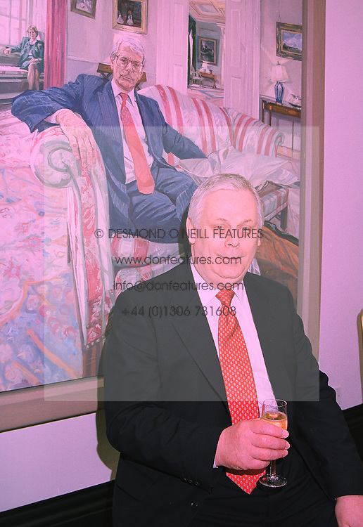 MR TERRY MAJOR-BALL in front of a portrait of his brother, former Prime Minister John Major, at a reception in London on 15th January 1998.MEO 27