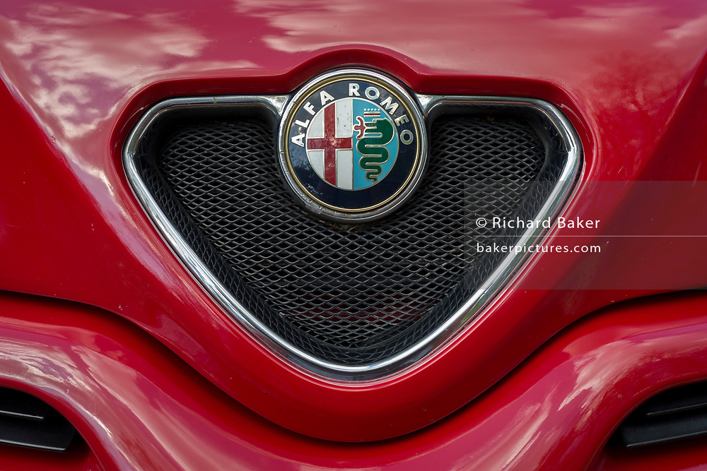 Detail of an Alfa Romeo grill and badge, on 23rd April 2017, in Wrington, North Somerset, England.