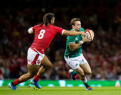 Jack Carty of Ireland under pressure from Josh Navidi of Wales<br /> <br /> Photographer Simon King/Replay Images<br /> <br /> Friendly - Wales v Ireland - Saturday 31st August 2019 - Principality Stadium - Cardiff<br /> <br /> World Copyright © Replay Images . All rights reserved. info@replayimages.co.uk - http://replayimages.co.uk