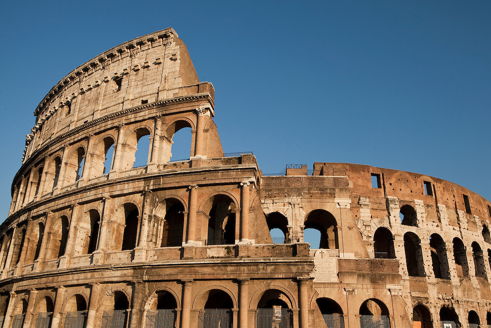 The Colosseum, or the Coliseum, is an elliptical amphitheatre in the centre of the city of Rome, Italy, the largest ever built in the Roman Empire. It is considered one of the greatest works of Roman architecture and Roman engineering. Inscription over the modern entrance recording the contributions of various popes and reflecting the Christian tradition that many martyrdoms occurred here.