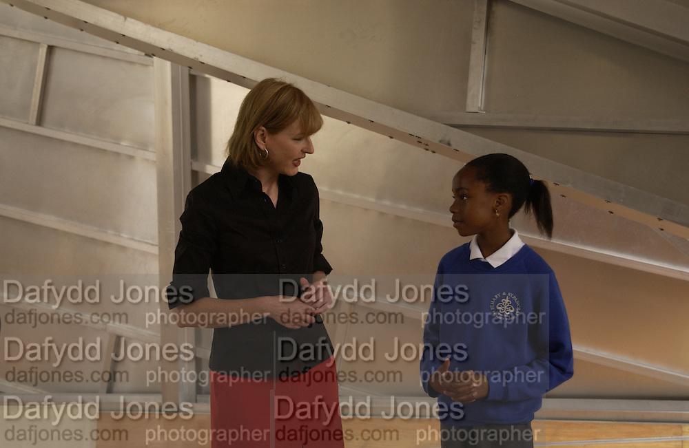 Julia Peyton-Jones with her shadow, Adaeze Chinwokwu. National Children's Art Day. © Copyright Photograph by Dafydd Jones 66 Stockwell Park Rd. London SW9 0DA Tel 020 7733 0108 www.dafjones.com