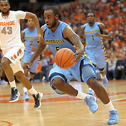 Marquette Golden Eagles guard Junior Cadougan (5) races up court on the fast break in the first half against the Syracuse Orange at the Carrier Dome in Syracuse, NY.  Number one ranked Syracuse leads Marquette 37-19 at the half.