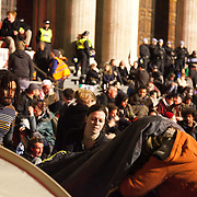 Setting up tent has never been easy. In the square. The London Stock Exchange was attempted occypied in solidarity with Occupy Wall in Street in New York and in protest againts the economic climate, blamed by many on the banks. Police managed to keep people away fro the Patornoster Sqaure and the Stcok Exchange and thousands of protestors stayid in St. Paul's Square, outside St Paul's Cathedral. Many camped getting ready to spend the night in the square.